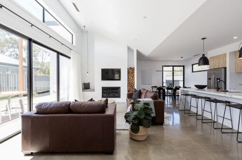 living room with polished concrete flooring by floortex industries