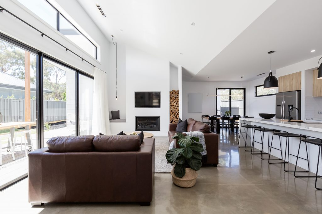 living area with polished concrete by floortex industries